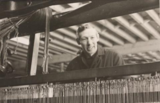 A man working at a loom